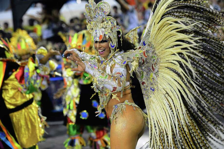 A reveler of Portela samba school performs during the first night of Carnival parade at the Sambadrome in Rio de Janeiro on February 11, 2013.       AFP PHOTO / CHRISTOPHE SIMON Photo: Getty