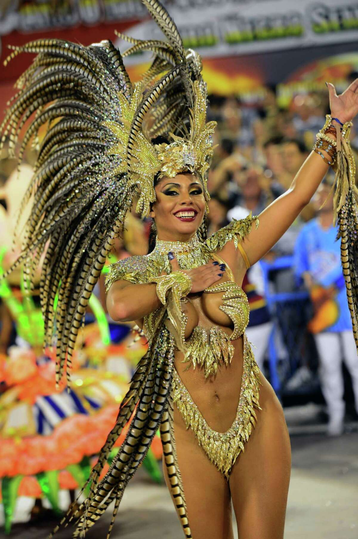 A reveler of Portela samba school performs during the first night of Carnival parade at the Sambadrome in Rio de Janeiro on February 11, 2013. AFP PHOTO / CHRISTOPHE SIMON