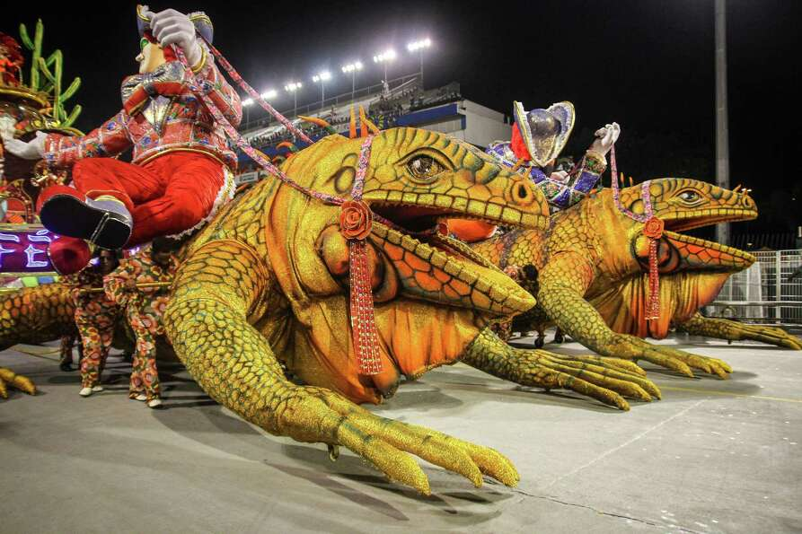 Dancers of the samba school Perola Negra dance during the carnival parade at the Anhembi Sambadrome