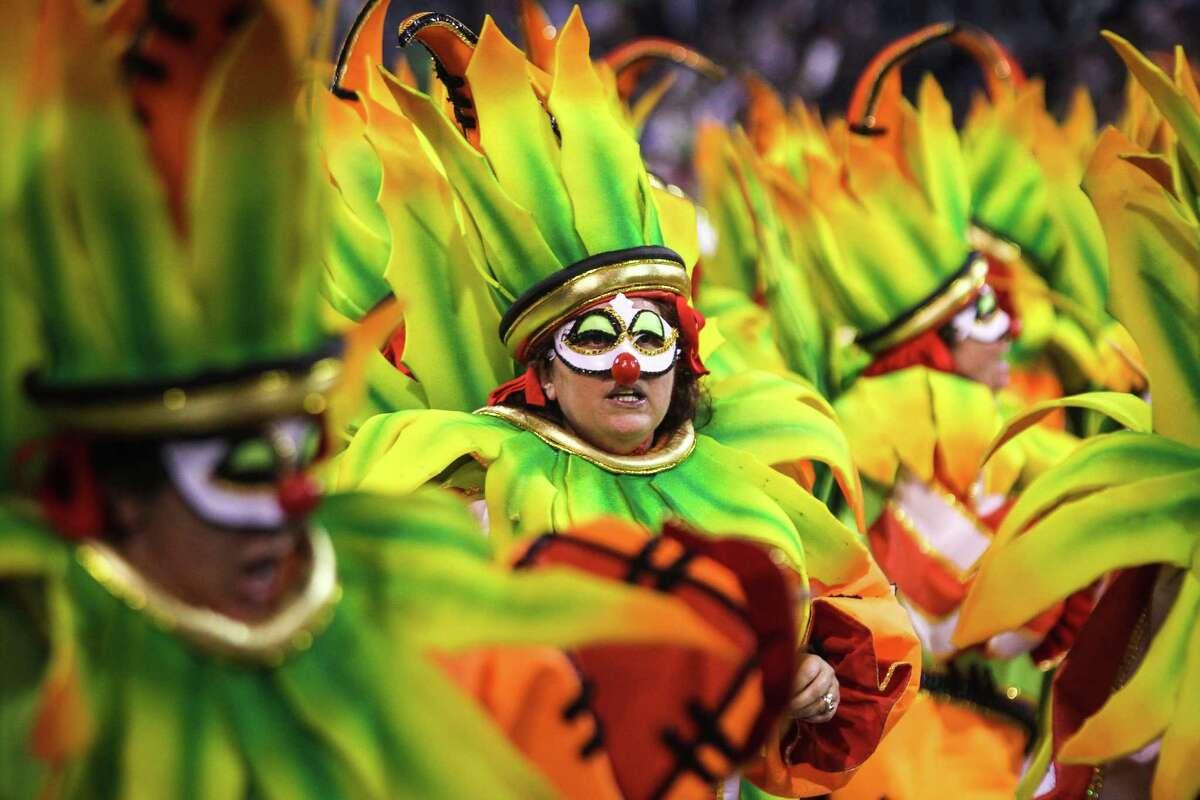 Dancers of the samba school Perola Negra dance during the carnival parade at the Anhembi Sambadrome on February 11, 2013 in Sao Paulo, Brazil.