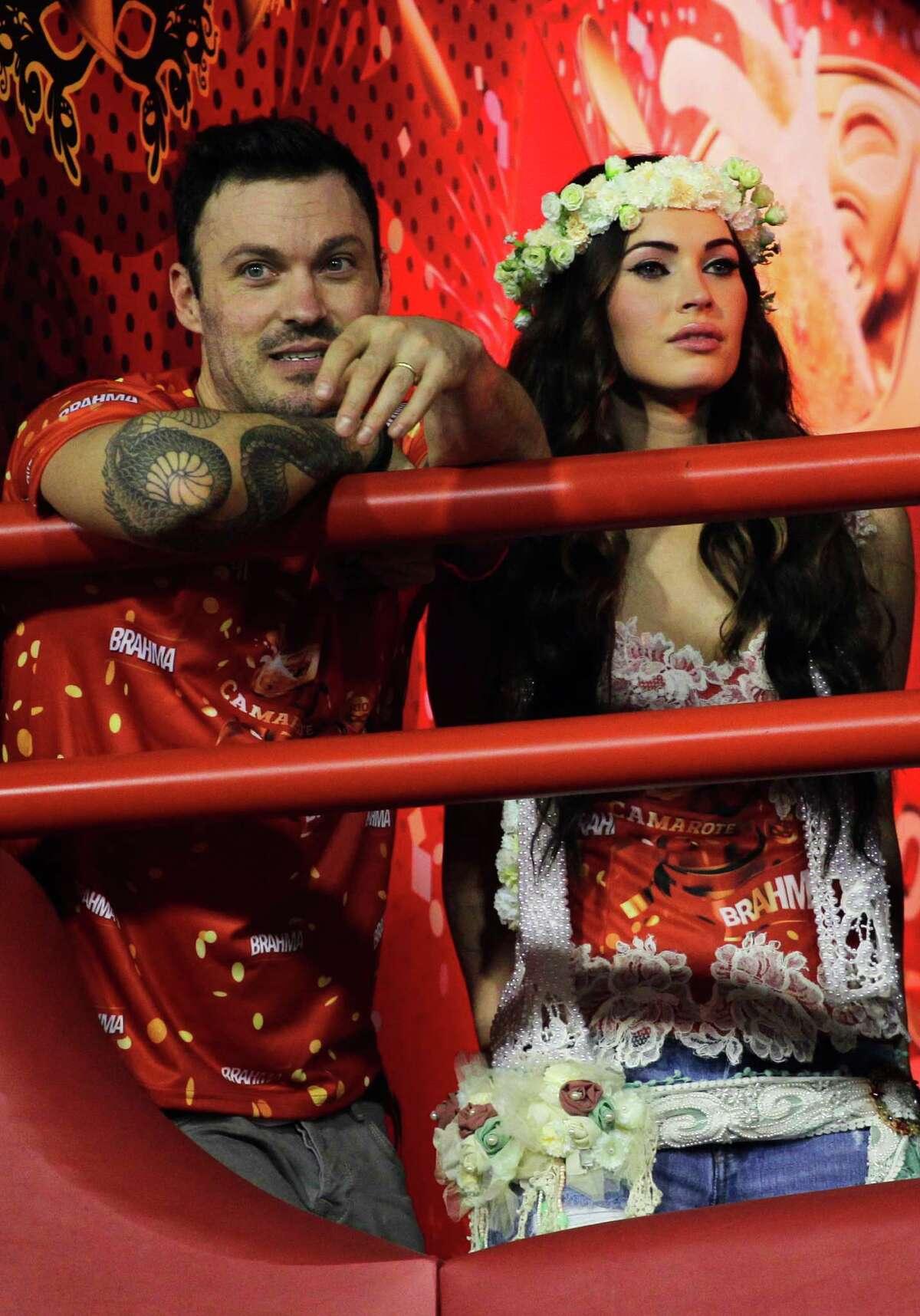 Megan Fox and her husband Brian Austin Green attend the carnival parades at the Sambadrome. (AP Photo/Hassan Ammar)