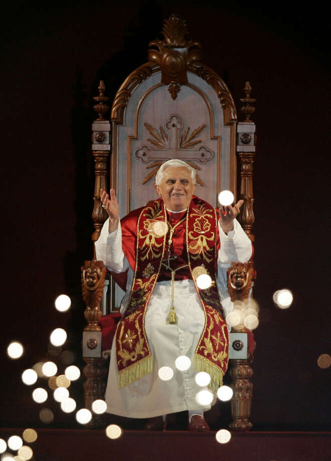 FILE - In this May 10, 2007 file photo, Pope Benedict XVI reacts while looking at fireworks during an event at the Pacaembu stadium in Sao Paulo, Brazil. On Monday, Feb. 11, 2013 the Vatican announced that Pope Benedict XVI will resign on Feb. 28, 2013.  (AP Photo/Silvia Izquierdo, file) Photo: Silvia Izquierdo, Associated Press / AP