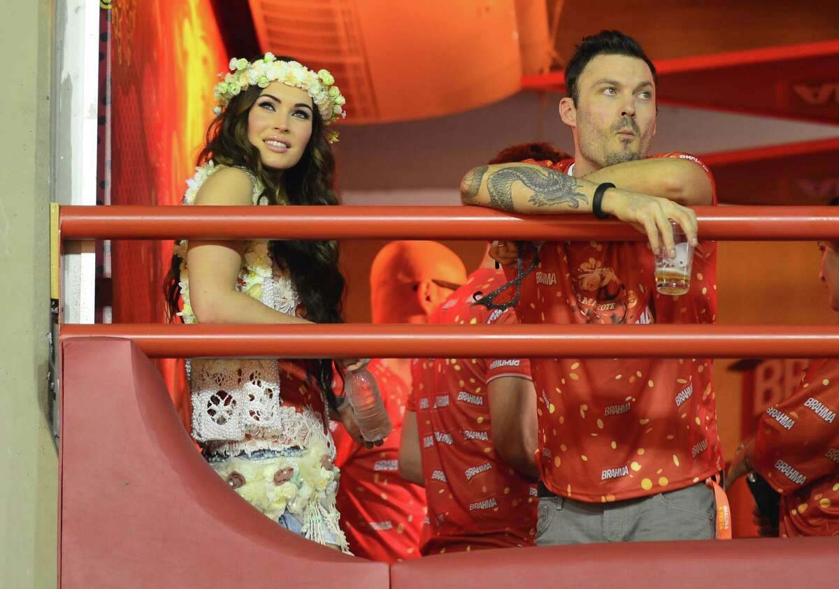 Megan Fox looks at Unidos da Tijuca samba school during the first night of Carnival parade at the Sambadrome in Rio de Janeiro on February 11, 2013. (CHRISTOPHE SIMON/AFP/Getty Images)