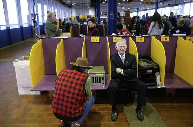 A visitor rests in a dog benching area during the 137th Westminster Kennel Club Dog Show on February 11, 2013 in New York City. A total of 2,721 dogs from 187 breeds and varieties are to compete in the event, hailed by organizers as the second oldest sporting competition in America, after the Kentucky Derby. The Best in Show dog is to be selected at Madison Square Garden Tuesday night. Photo: John Moore, Getty Images / 2013 Getty Images