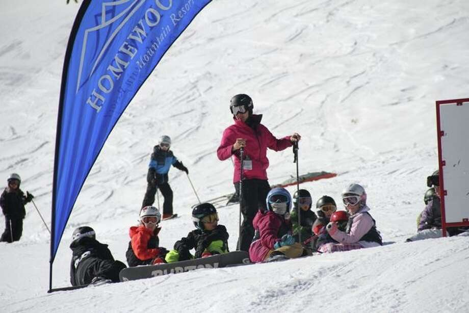 Competitors contemplate their big moves before the Snowbomb Lil' Air competition. (Justin Dohms/Special to The Chronicle)