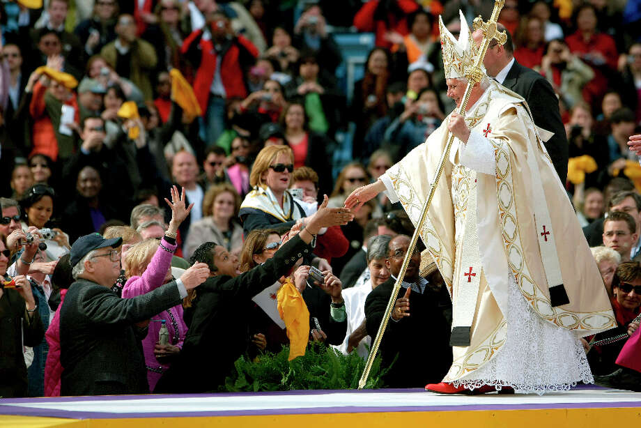 Pope Benedict XVI greets members of the crowd as he arrives to celebrate Mass at Yankee Stadium in New York, April 20, 2008. Citing advanced years and infirmity, Pope Benedict XVI stunned the Roman Catholic world on Feb. 11, 2013 by saying that he would resign on Feb. 28 after less than eight years in office, the first pope to do so in six centuries. Photo: CHANG W. LEE, Chang W. Lee/The New York Times / Connecticut Post Contributed The New York Times via Associated Press
