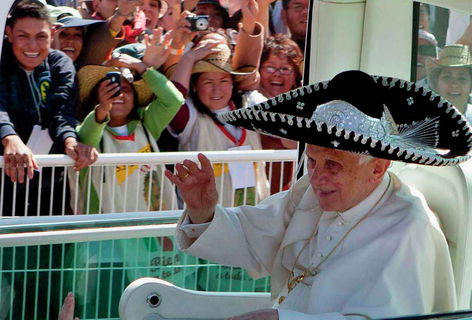 FILE - In this March 25, 2012 file photo, Pope Benedict XVI waves from the popemobile wearing a Mexican sombrero as he arrives to give a Mass in Bicentennial Park near Silao, Mexico. On Monday, Feb. 11, 2013 the Vatican announced that Pope Benedict XVI will resign on Feb. 28, 2013. (AP Photo/Eduardo Verdugo, file) Photo: Eduardo Verdugo, Associated Press / AP