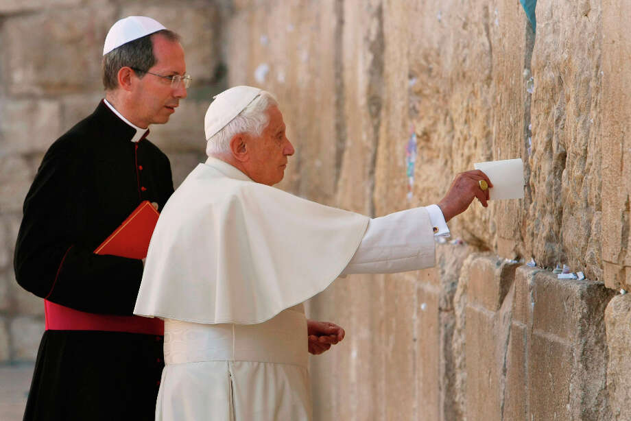 FILE - In this Tuesday, May 12, 2009 file photo, Pope Benedict XVI places a note in the Western Wall, Judaism's holiest site, in Jerusalem's Old City. Benedict announced Monday Feb. 11, 2013 he would  resign Feb. 28, the first pontiff to do so in nearly 600 years.(AP Photo/David Silverman, Pool) Photo: David Silverman, Associated Press / Pool