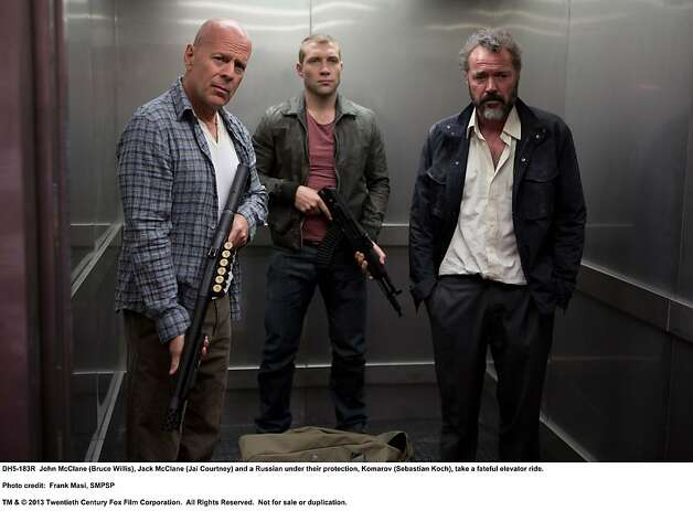 A GOOD DAY TO DIE HARDJohn McClane (Bruce Willis), Jack McClane (Jai Courtney) and a Russian under their protection, Komarov (Sebastian Koch), take a fateful elevator ride.Photo Credit: Frank Masi, SMPSPTM & © 2013 Twentieth Century Fox Film Corporation.  All Rights Reserved.  Not for sale or duplication. Photo: Frank Masi, SMPSP, Twentieth Century Fox