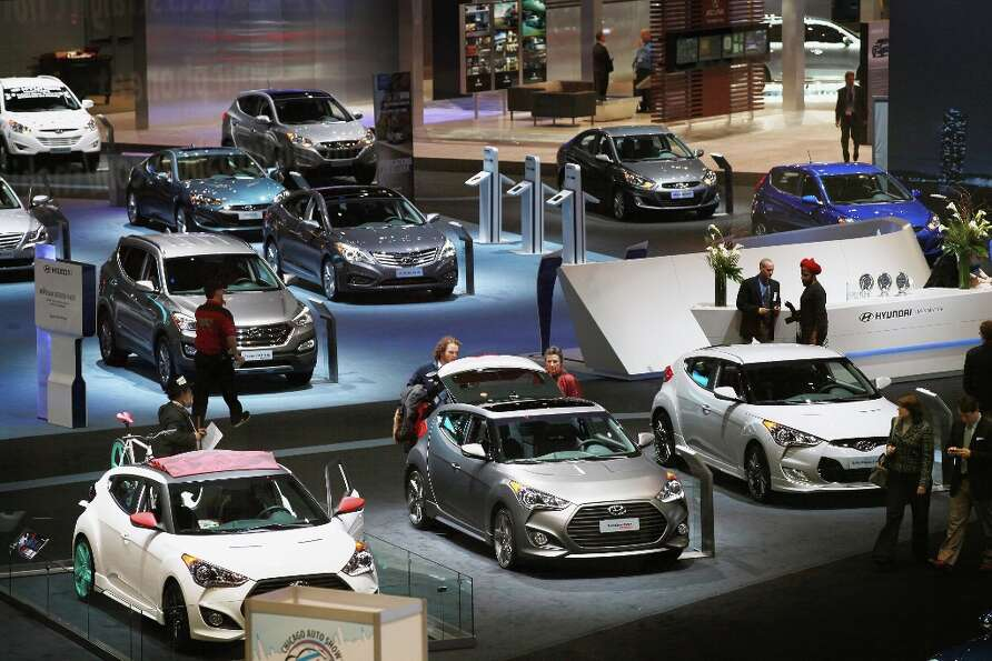 CHICAGO, IL - FEBRUARY 07:  Visitors look over Hyundai cars during a media preview day at the Chicag