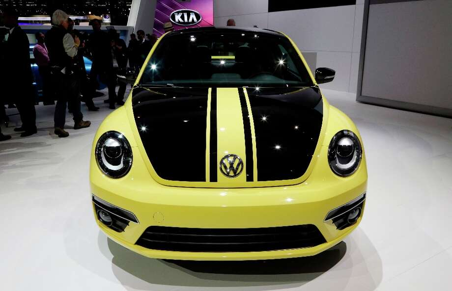 Volkswagen's Beetle GSR is presented during the media preview of the Chicago Auto Show at McCormick Place in Chicago on Thursday, Feb. 7, 2013. (AP photo/Nam Y. Huh) Photo: Nam Y. Huh, Associated Press / AP