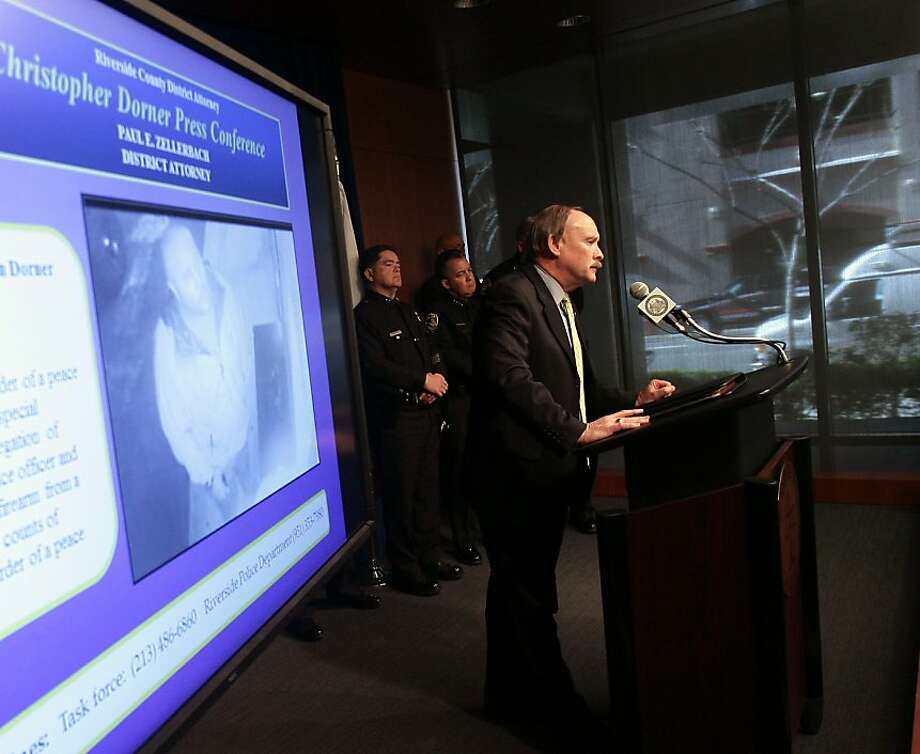 Riverside County District Attorney Paul Zellerbach announces the murder charges at a heavily guarded news conference, saying every police officer in Southern California is in danger. Photo: Stan Lim, Associated Press