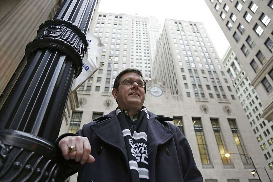 Sean Toohey, a grains broker at the Chicago Board of Trade, who had hip replacement surgery last summer ,walks home from work Monday, Feb. 11, 2013, in Chicago. Routine hip replacement surgery on a healthy patient may cost as little as $11,000 _ or up to nearly $126,000. Toohey said he has good health insurance that covered most of the costs, and it didn't occur to him to ask about price beforehand. (AP Photo/M. Spencer Green) Photo: M. Spencer Green, Associated Press