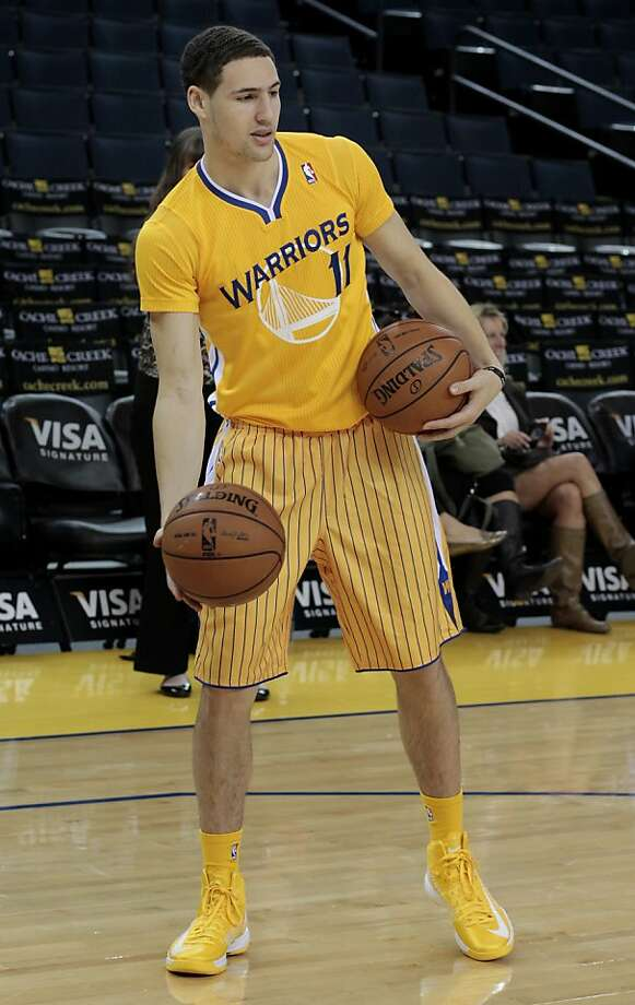 The Warriors Clay Thompson moved around the court in the new uniform. The Golden State Warriors and Adidas unveiled a new lightweight uniform for the team Monday February 11, 2013. The adizero short sleeve NBA uniform is 26 percent lighter than the current uniforms. Photo: Brant Ward, The Chronicle