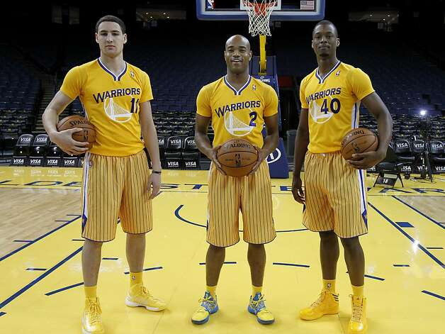 Three members of the Warriors, (l-r): Clay Thompson, Jarrett Jack and Harrison Barnes showed off the new short sleeve look. The Golden State Warriors and Adidas unveiled a new lightweight uniform for the team Monday February 11, 2013. The adizero short sleeve NBA uniform is 26 percent lighter than the current uniforms. Photo: Brant Ward, The Chronicle