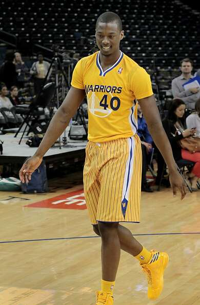 Warriors rookie Harrison Barnes modeled the new uniform on the basketball floor. The Golden State Wa