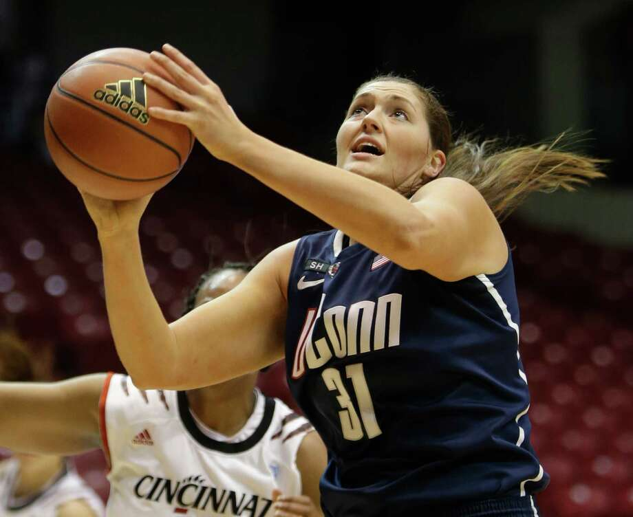 Connecticut center Stefanie Dolson (31) in action against Cincinnati in an NCAA college basketball game, Saturday, Jan. 26, 2013 in Cincinnati. Dolson scored 15 points to lead Connecticut to a 67-31 win. (AP Photo/Al Behrman) Photo: Al Behrman, Associated Press / AP