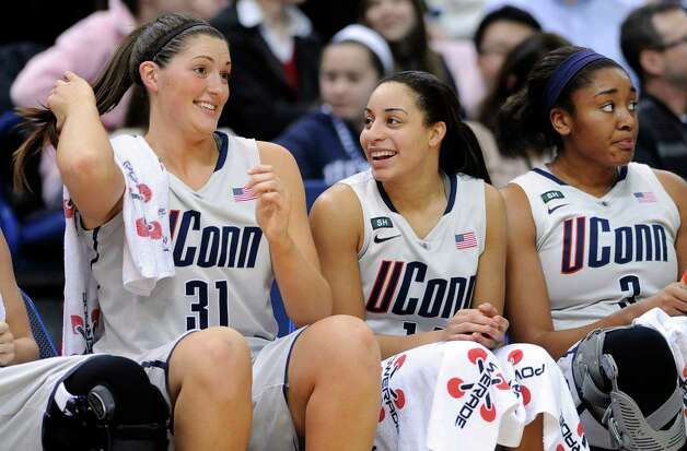 Connecticut's Stefanie Dolson, left, Bria Hartley, center and Morgan Tuck react late in the second half of the team's 76-43 victory over Villanova in an NCAA college basketball game in Hartford, Conn., Tuesday, Jan. 29, 2013. (AP Photo/Fred Beckham) Photo: Fred Beckham, Associated Press / FR153656 AP