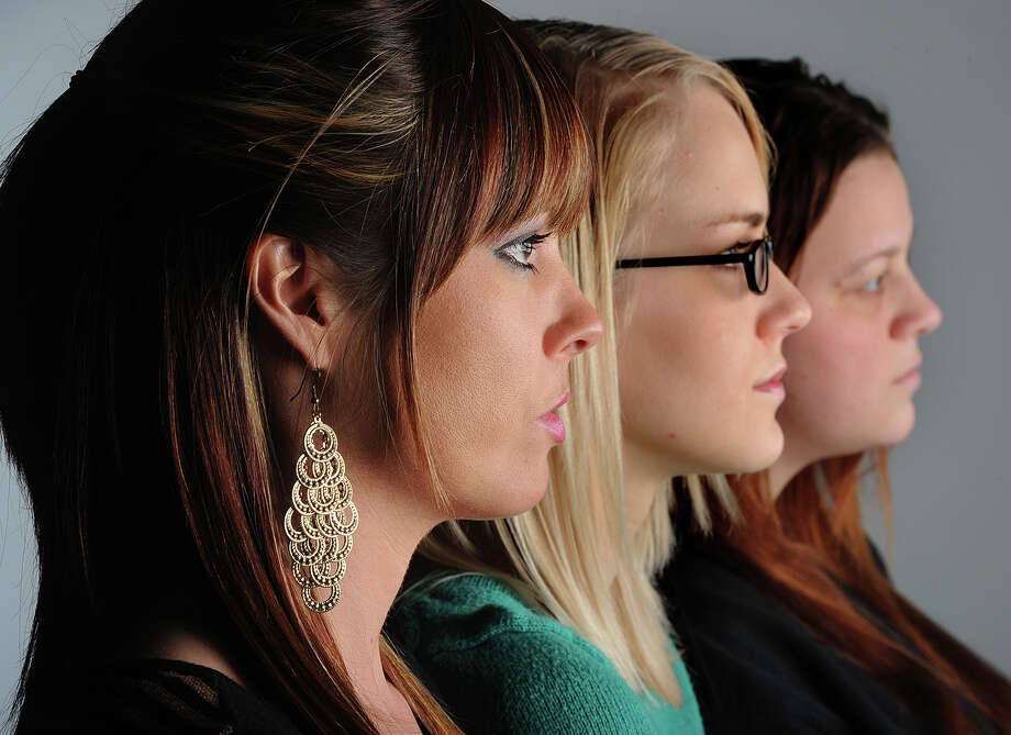 From left, Hollie Toups, 32, Marianna Taschinger, 22, and Kelly Hinson, 27, are among more than 20 Southeast Texan women to join in a class action lawsuit against a 'revenge porn' website that allows anonymous users to post intimate pictures of the women without their consent.   Photo taken Friday, January 18, 2013 Guiseppe Barranco/The Enterprise Photo: Guiseppe Barranco, STAFF PHOTOGRAPHER / The Beaumont Enterprise
