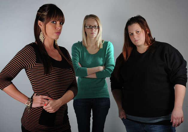 From left, Hollie Toups, 32, Marianna Taschinger, 22, and Kelly Hinson, 27, are among more than 20 Southeast Texan women to join in a class action lawsuit against a 'revenge porn' website. Photo taken Friday, January 18, 2013 Guiseppe Barranco/The Enterprise Photo: Guiseppe Barranco, STAFF PHOTOGRAPHER / The Beaumont Enterprise