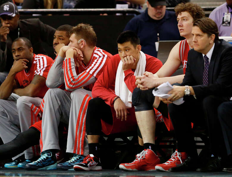 Rockets players wash the closing moments of their loss to the Kings.