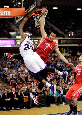 Kings guard Isaiah Thomas is fouled by Rockets point guard Jeremy Lin. Photo: Rich Pedroncelli