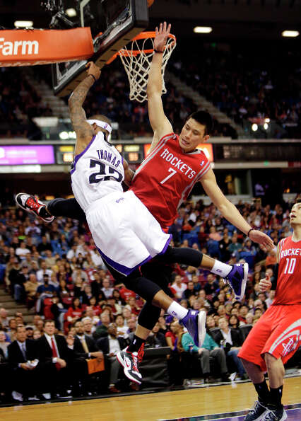 Kings guard Isaiah Thomas is fouled by Rockets point guard Jeremy Lin.