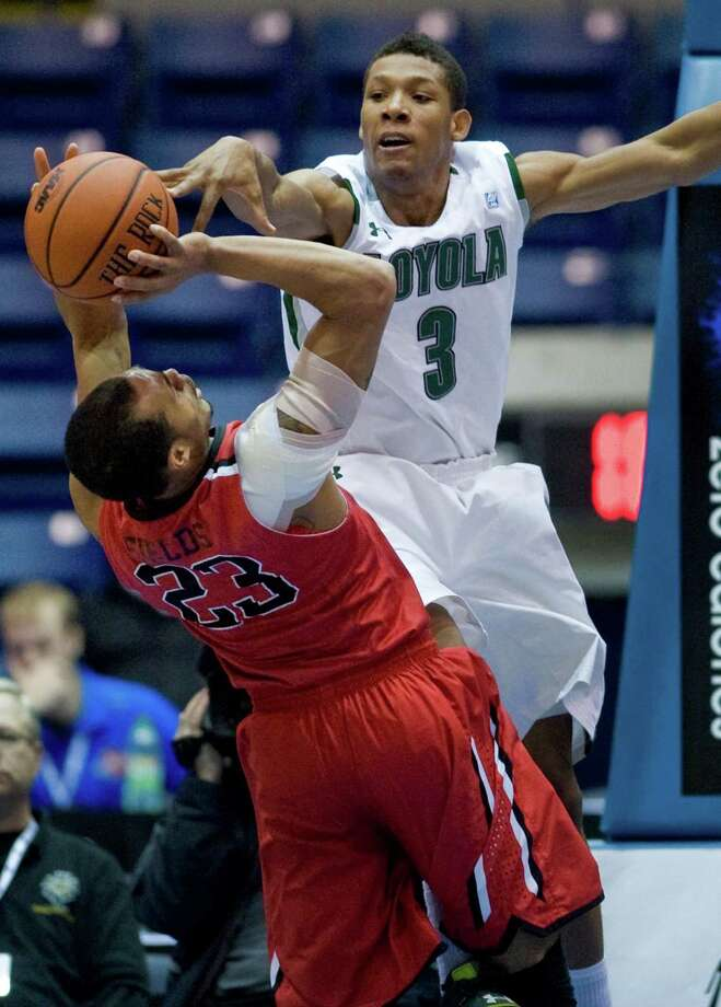 Loyola's Dylon Cormier (3) reaches for the ball as Fairfield's Jamel Fields (23) shoots in the first half of an NCAA college basketball game for the championship of the Metro Atlantic Athletic Conference tournament in Springfield, Mass., Monday, March 5, 2012. (AP Photo/Jessica Hill) Photo: Jessica Hill, Associated Press / AP2012