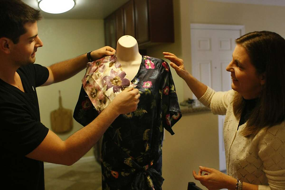 Koray and Maria Lucas sample different fabrics which they make gowns out of for cancer patients on Saturday, Feb. 2. The mother-son duo have made over 500 gowns for cancer patients.