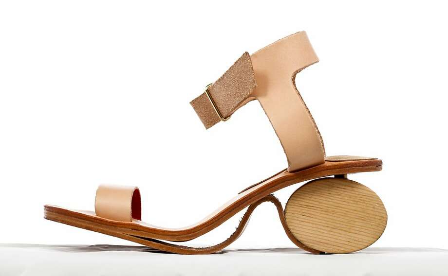 "The Sugi heel, $300, provides a literal mixing of ""high and low"" fashion, with bearings that provide two- or three-inch heel height depending on which way the ellipse is positioned. Photo: Russell Yip, The Chronicle"
