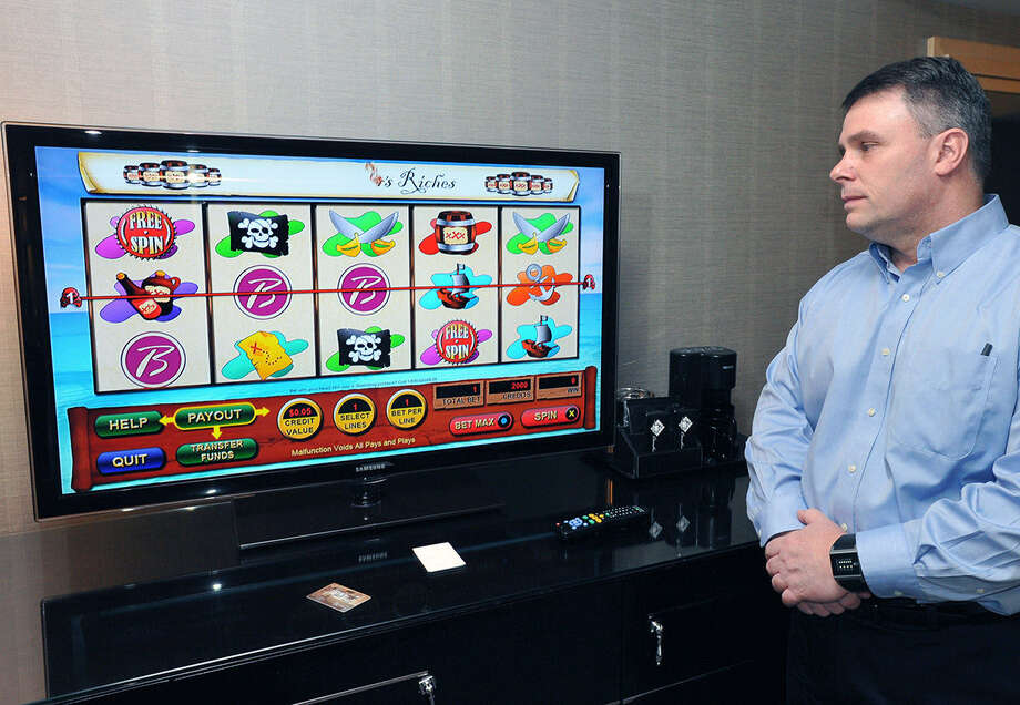 John Forelli, vice president of information technology for the Borgata Hotel Casino & Spa in Atlantic City, N.J., shows how the hotel's in-room gaming on a television works. Photo: Michael Ein / Press Of Atlantic City