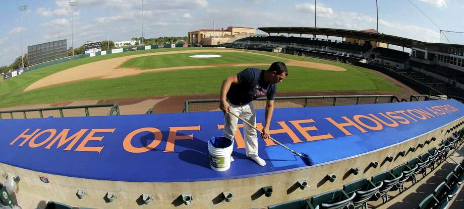 A fresh season requires a fresh coat of paint from Geo Rodriguez on the dugout at Osceola County Stadium on Monday. Pitchers and catchers reported Monday, and the first formal workout of spring training is today. Photo: David J. Phillip, STF / AP