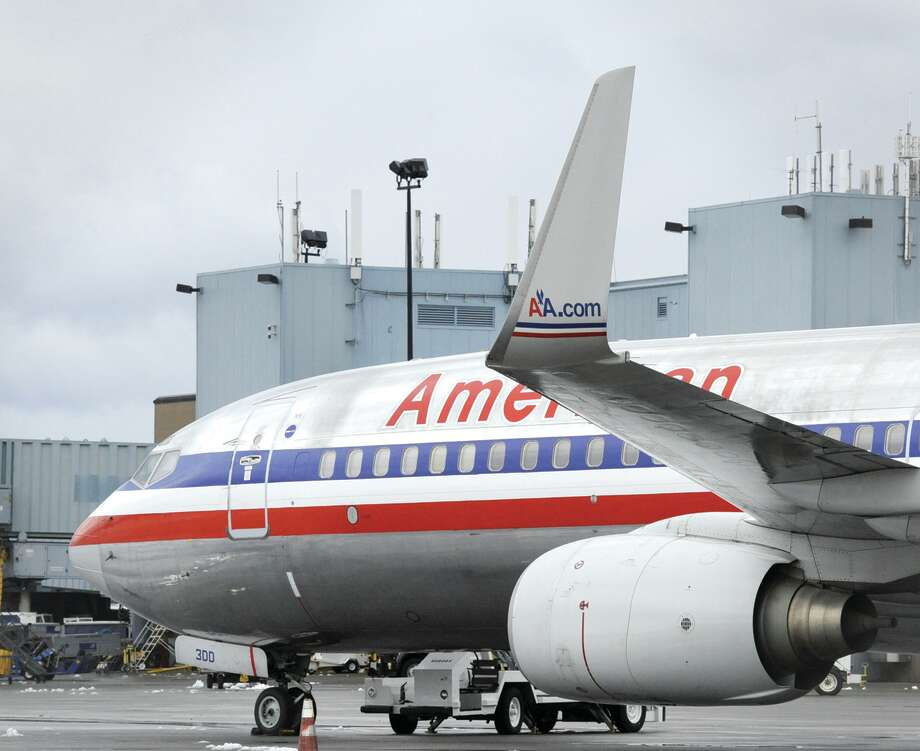 The American Airlines 737 sits on the apron of the Albany International Airport in Colonie, N.Y. Jan. 13, 2012  ( Skip Dickstein/Times Union) Photo: Skip Dickstein / 2011