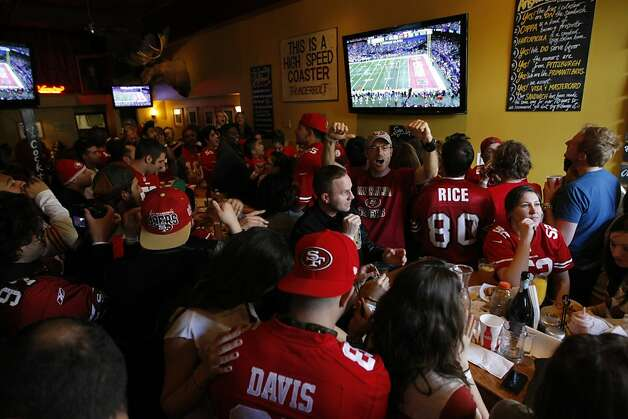 49ers fans cheer as they watch the Super Bowl at Giordano Bros. on 16th St. Sunday Feb. 3. Many 49ers fans took to the Mission District to watch the Super Bowl. Photo: James Tensuan, The Chronicle