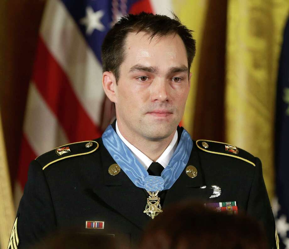 Medal of Honor recipient, retired Staff Sgt. Clinton Romesha is seen on stage during the ceremony in the East Room of the White House in Washington, Monday, Feb. 11, 2013, where President Barack Obama bestowed the medal. Romesha's leadership during a daylong attack by hundreds of fighters on Combat Outpost Keating in Afghanistan led to award. (AP Photo/Pablo Martinez Monsivais) Photo: Pablo Martinez Monsivais