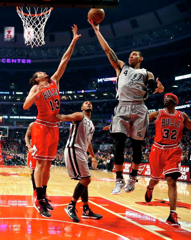 Spurs guard Danny Green (4) drives to the basket past Bulls center Joakim Noah (13) and guard Richard Hamilton (32) as Spurs' Boris Diaw watches during the first half Monday, Feb. 11, 2013, in Chicago. Photo: Charles Rex Arbogast, Associated Press / AP