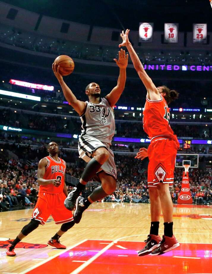 Spurs center Boris Diaw (33) shoots over Bulls center Joakim Noah (13) as forward Luol Deng watches during the first half  Monday, Feb. 11, 2013, in Chicago. Photo: Charles Rex Arbogast, Associated Press / AP