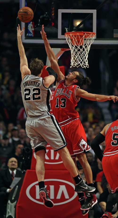 Joakim Noah (13) of the Bulls tries to block a shot by Tiago Splitter (22) of the Spurs at the United Center on Feb. 11, 2013 in Chicago. Photo: Jonathan Daniel, Getty Images / 2013 Getty Images