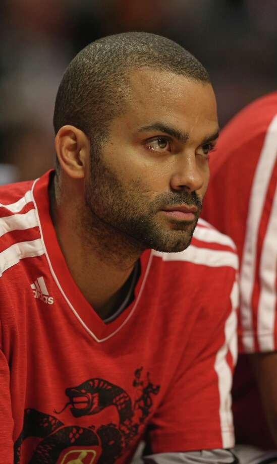 Tony Parker of the Spurs watches from the bench as his teammates take on the Bulls at the United Center on Feb. 11, 2013 in Chicago. Photo: Jonathan Daniel, Getty Images / 2013 Getty Images