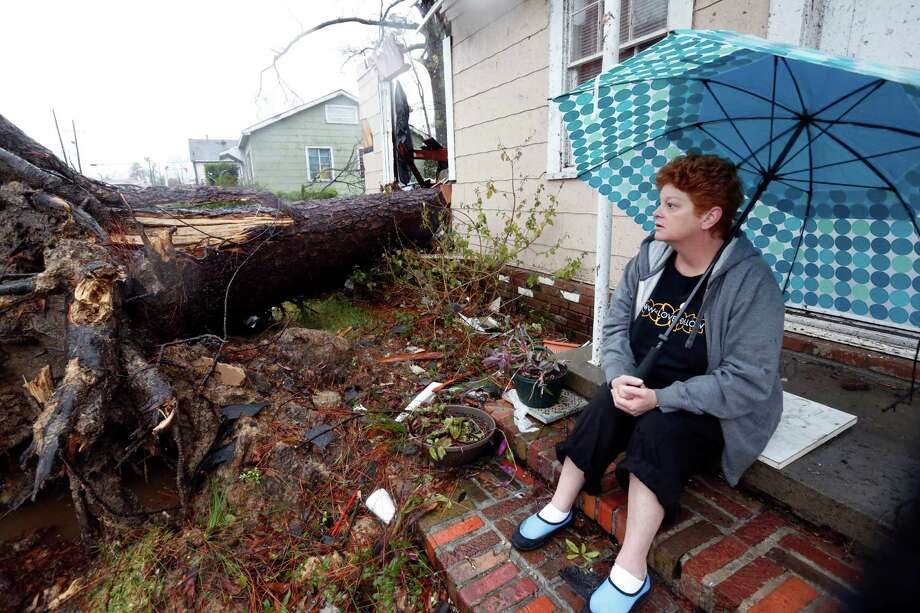 Hellen Chmiel, 57, sits in front of the remains of her home in Hattiesburg, Miss., Monday, Feb. 11, 2013, following a Sunday afternoon tornado that caused much damage throughout the South Mississippi college town. Chmiel, who was out of her house when the tornado struck, said the large pine tree in the front yard completely destroyed her bedroom. (AP Photo/Rogelio V. Solis) Photo: Rogelio V. Solis