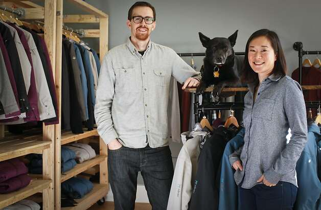 Tim and Joanne Medvitz sell their Pop Outerwear at their appointment-only storefront showroom below their Haight-Ashbury home. Joanne wears the company's tailored button-down shirt ($91). Photo: Russell Yip, The Chronicle
