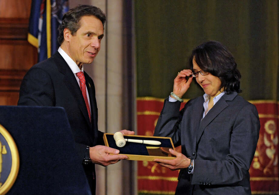 NYS Governor Andrew Cuomo presents Jenny Rivera the gavel of the late Judge Benjamin Cardozo after she is voted in as a judge on the NYS Court of Appeals by the Senate at the Capitol on Monday Feb. 11, 2013 in Albany, N.Y. (Lori Van Buren / Times Union) Photo: Lori Van Buren