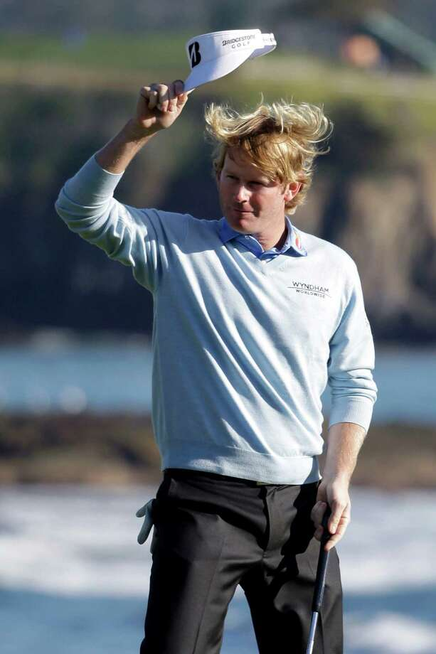 Brandt Snedeker raises his visor on the 18th green of the Pebble Beach Golf Course after winning the AT&T Pebble Beach Pro-Am golf tournament, Sunday, Feb. 10, 2013, in Pebble Beach, Calif. (AP Photo/Eric Risberg) Photo: Eric Risberg