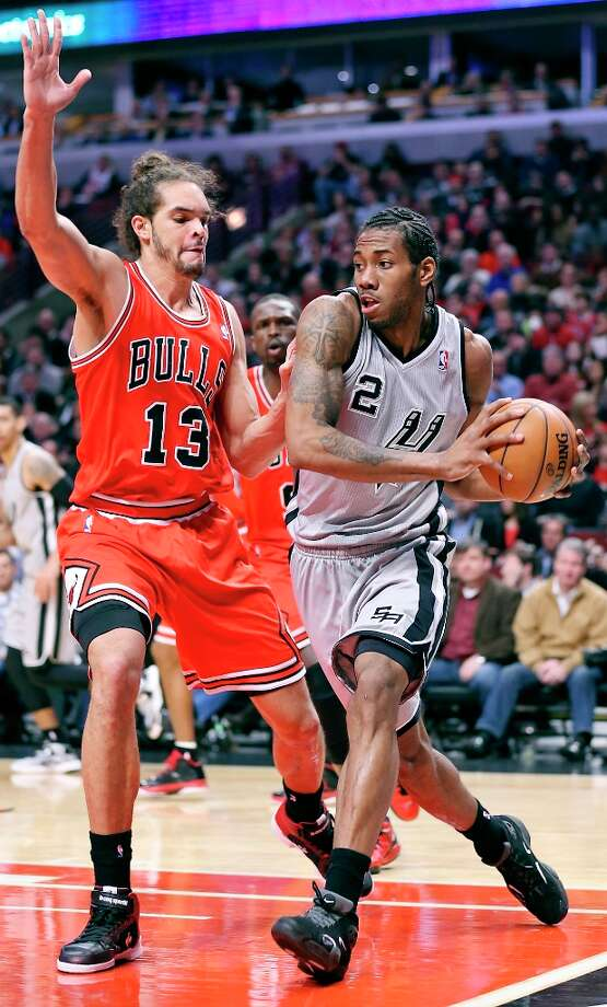 The Spurs' Kawhi Leonard looks for room around Chicago Bulls' Joakim Noah during second half action Monday Feb. 11, 2013 at the United Center in Chicago. The Spurs won 103-89. Photo: Edward A. Ornelas, San Antonio Express-News / © 2013 San Antonio Express-News