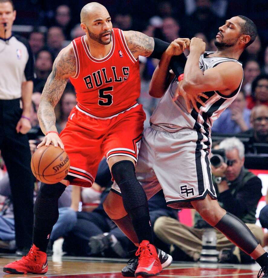 The Spurs' Boris Diaw defends Chicago Bulls' Carlos Boozer during first half action Monday, Feb. 11, 2013 at the United Center in Chicago. Photo: Edward A. Ornelas, San Antonio Express-News / © 2013 San Antonio Express-News