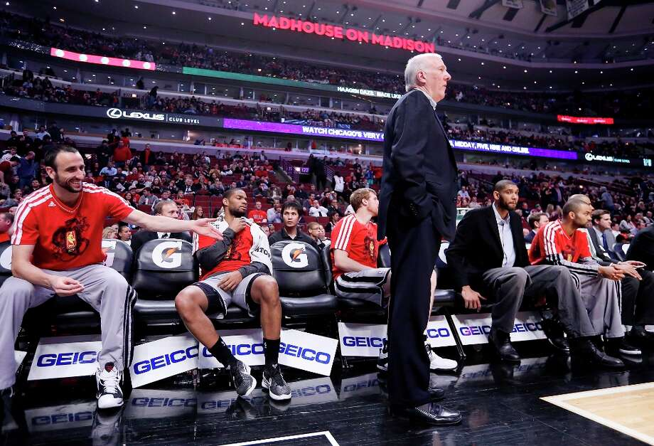 Spurs coach Gregg Popovich (center) watches the game from the bench with the team during second half action against the Chicago Bulls'  Monday Feb. 11, 2013 at the United Center in Chicago. The Spurs won 103-89. Photo: Edward A. Ornelas, San Antonio Express-News / © 2013 San Antonio Express-News