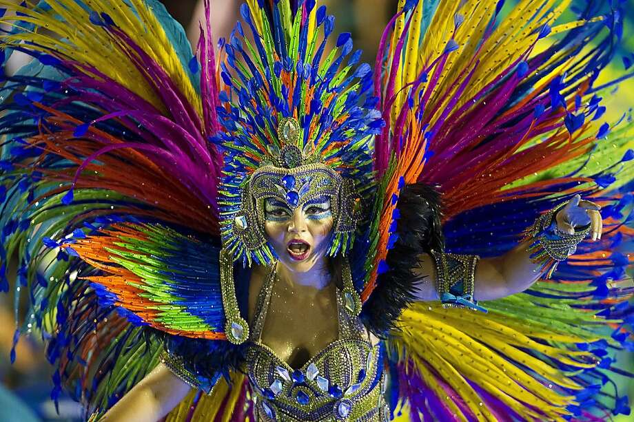TOPSHOTS  Revelers of Portela samba school perform during the first night of Carnival parade at the Sambadrome in Rio de Janeiro, Brazil on February 11, 2013. AFP PHOTO/ANTONIO SCORZAANTONIO SCORZA/AFP/Getty Images Photo: Antonio Scorza, AFP/Getty Images