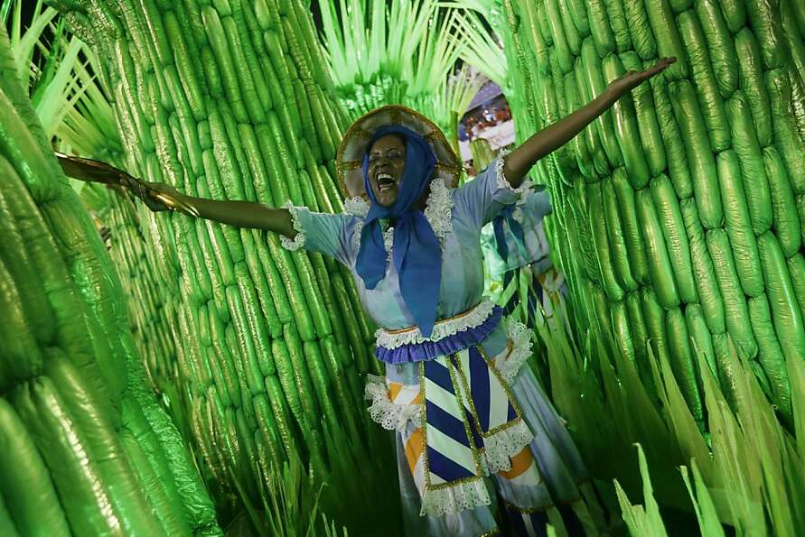 A performer from the Portela samba school parades during carnival celebrations at the Sambadrome in