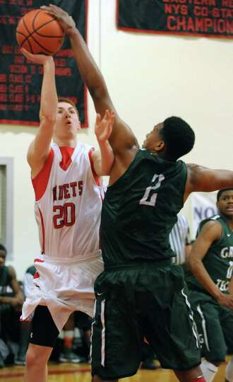 Albany Academy's Matt Knezovic drives to the basket against Green Tech's Desonte Welch during a bask