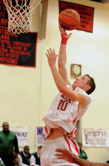 Albany Academy's John Moutopoulos drives to the basket during a basketball game against Green Tech o
